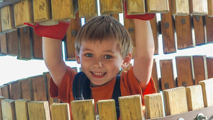 Young boy on ropes course
